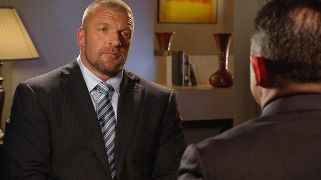 Triple H and Michael Cole